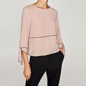 Zara pink blouse with black piping
